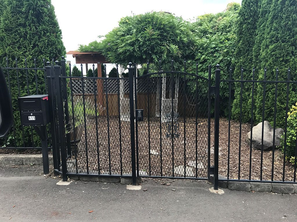 Iron gate with security measures like mesh and combination lock