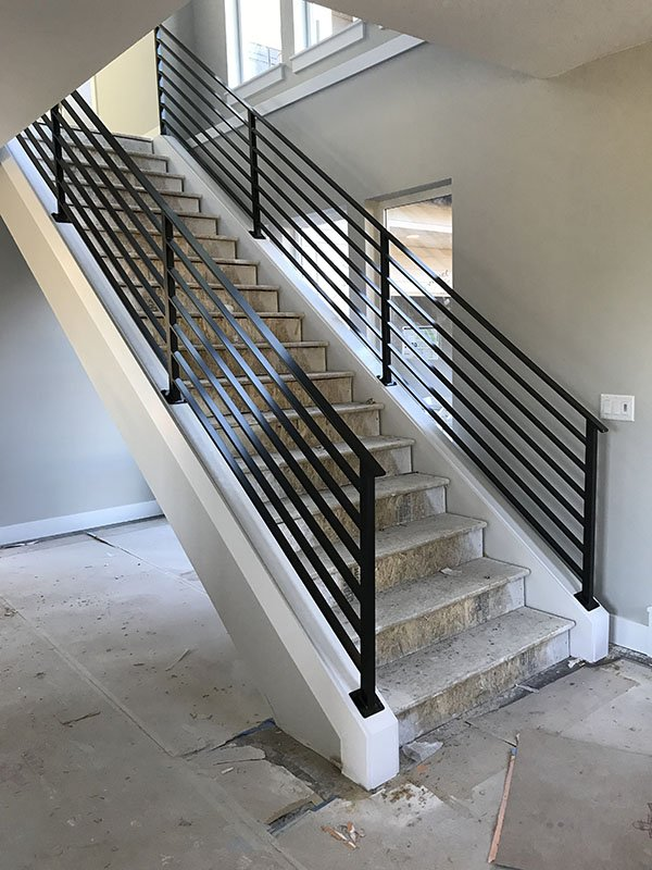 horizontal slat iron rails for interior staircase with black powder coat finish