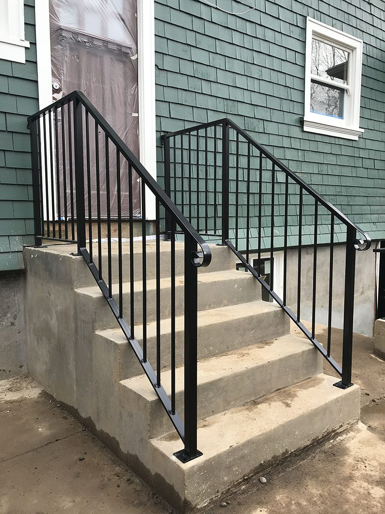 plain vertical picket iron rails finished in black powder coating