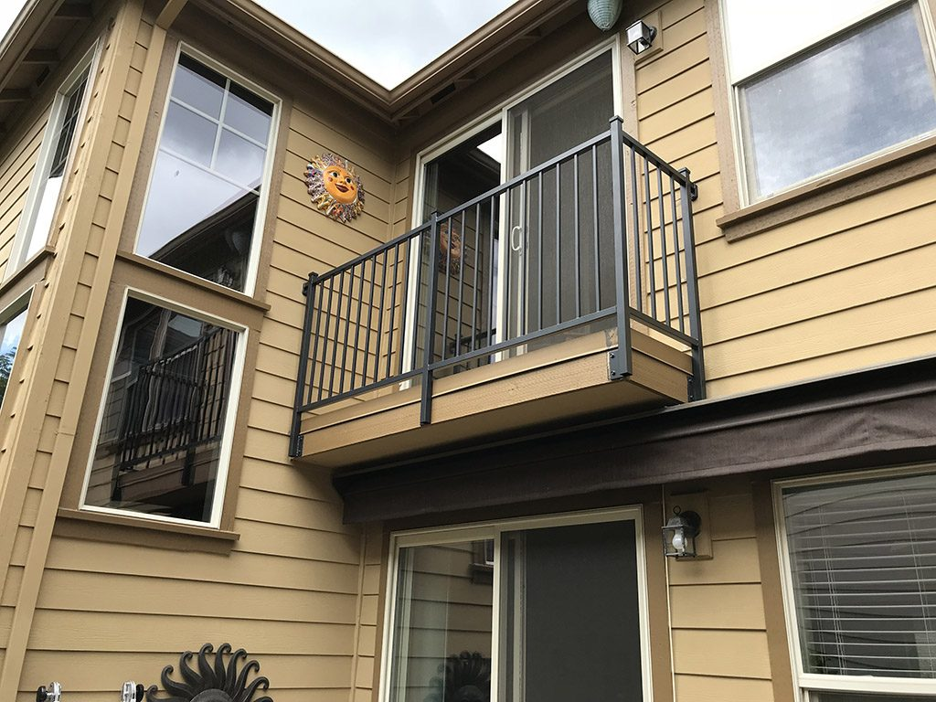 plain vertical picket facia mounted iron deck rail
