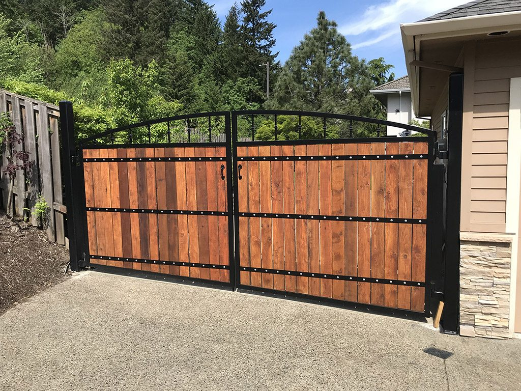 custom iron gates, security gates, ornamental gates, driveway gates and man gates custom iron work, iron fabricator